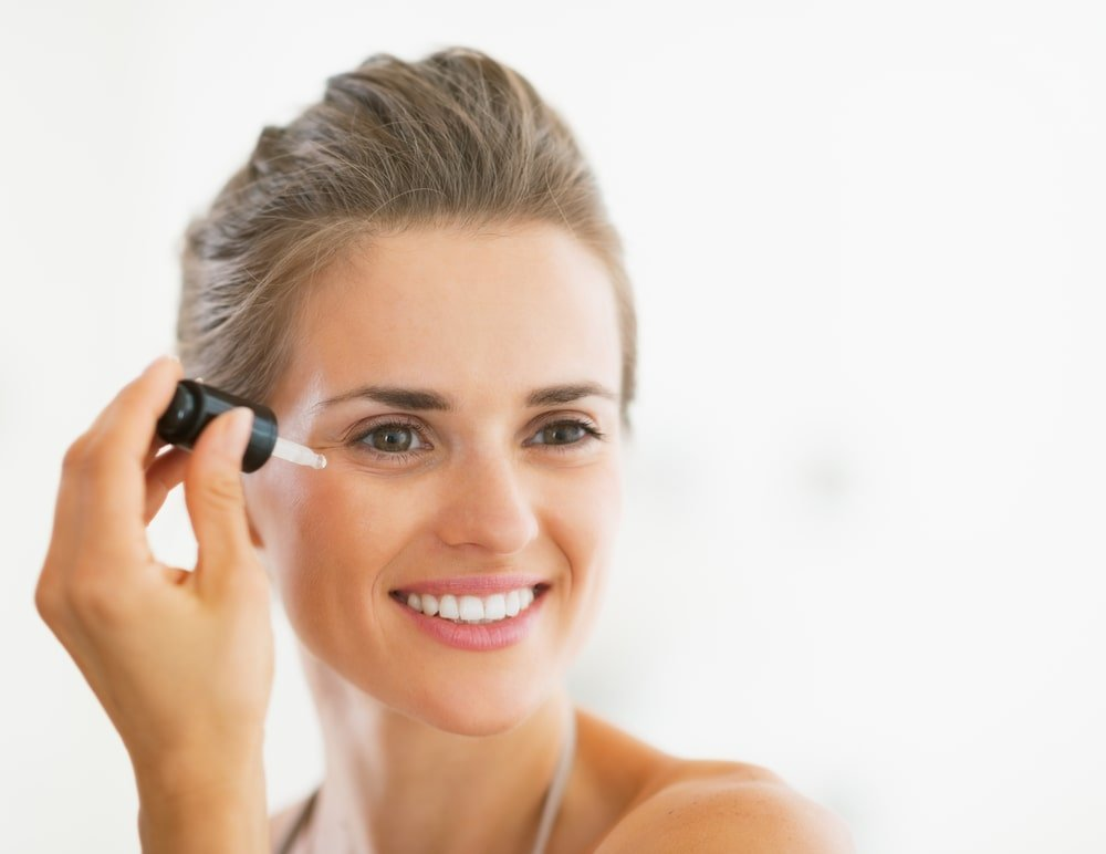 woman using serum on face for oily skin